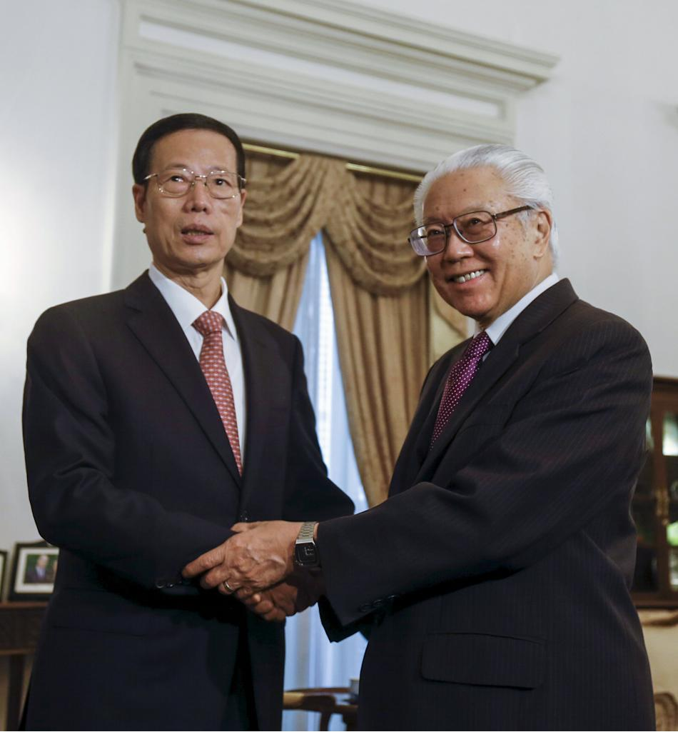 Zhang and Tony Tan shake hands at the Istana in Singapore