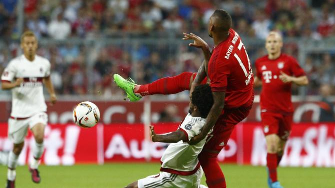 Bayern Munich's Boateng fights for the ball with AC Milan's Sousa during their pre-season Audi Cup tournament soccer match in Munich