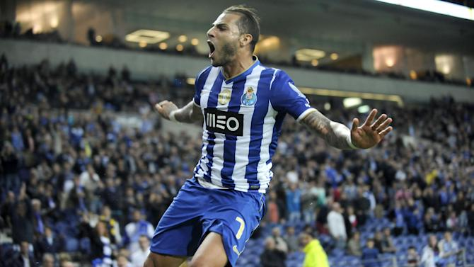 FC Porto's Ricardo Quaresma celebrates after scoring the team's third goal against Arouca in a Portuguese League soccer match at the Dragao stadium, in Porto, Portugal, Sunday March 9, 2014