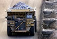File photo of a dump truck carrying gold-bearing ore at Kalgoorlie, east of Perth. Australia said Friday the world expects it to do its part to reduce pollution linked to global warming as the nation counts down to controversial new taxes on carbon emissions and mining profits