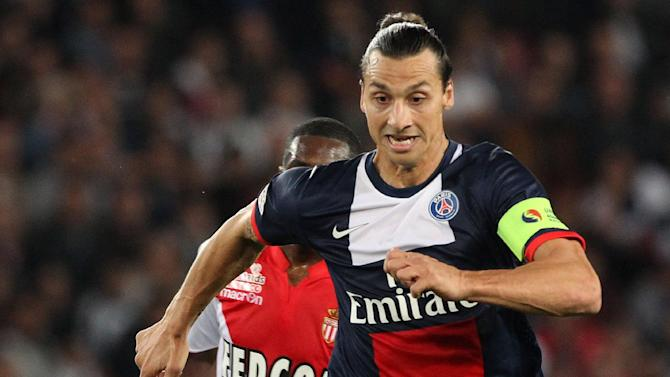 Paris Saint Germain's forward Zlatan Ibrahimovic from Sweden, right,  runs with the ball ahead of Monaco's Geoffrey Kondogbia, during their French League One soccer match, at the Parc des Princes stadium, in Paris, Sunday, Sept. 22, 2013