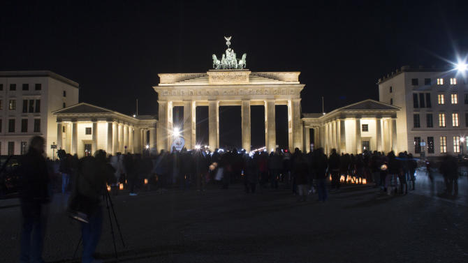 The illuminated Brandenburger Gate is seen prior to Earth Hour in Berlin, Saturday, March 23, 2013. Earth Hour was marked worldwide at 8.30 p.m. local time and is a global call to turn off lights for 60 minutes in a bid to highlight the global climate change.(AP Photo/Markus Schreiber)