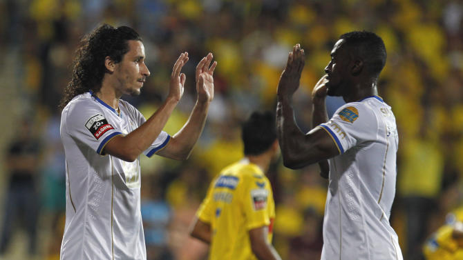 """Porto's Luis """"Lica"""" Carneiro, left, celebrates with teammate Jackson Martinez, from Colombia, after scoring the opening goal against Estoril during their Portuguese league soccer match at the Antonio Coimbra da Mota stadium in Estoril, near Lisbon, Sunday, Sept. 22, 2013"""