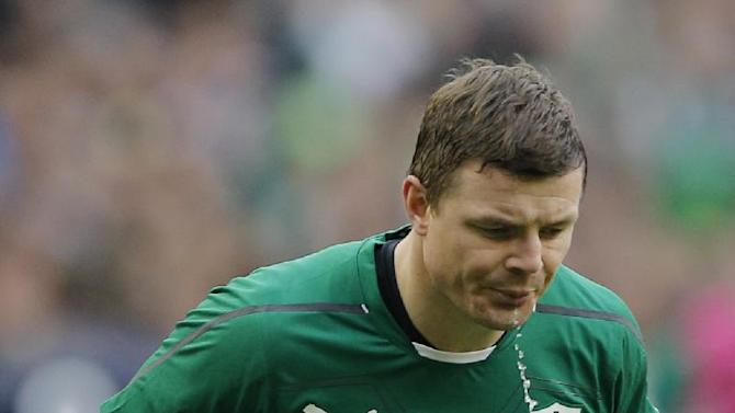 Ireland's Brian O'Driscoll spits out water during the Six Nations Rugby Union match between France and Ireland at the Stade de France stadium, in Saint Denis, outside Paris, Saturday March 15, 2014