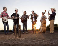 """This undated image released by ATO Records shows members of Old Crow Medicine Show, from left, Kevin Hayes, Gill Landry, Chance McCoy, Ketch Secor, Morgan Jahnig, and Critter Fuqua. The band's fourth album is called. """"Carry Me Back."""" (AP Photo/ ATO Records)"""