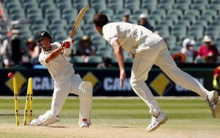 Australia's Josh Hazlewood bowls New Zealand's Trent Boult for five runs during the third day of the third cricket test match at the Adelaide Oval, in South Australia