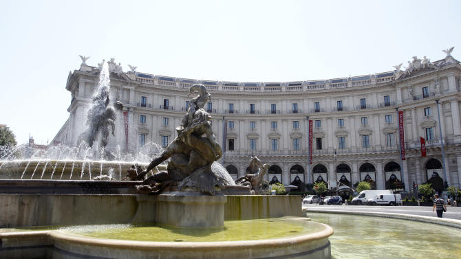 A view of the Exedra hotel, building in the background, where actor James Gandolfini was staying while vacationing in Rome, Thursday, June 20, 2013. Gandolfini, 51, suffered a fatal cardiac arrest and was pronounced dead at 11 p.m. (2100 GMT; 5 p.m. EDT) Wednesday in Rome after being rushed by ambulance to the Policlinic Umberto I hospital. In the foreground is the Fountain of the Naiads. (AP Photo/Riccardo De Luca)