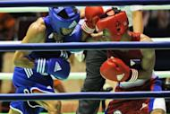 Mark Anthony Barriga (R) of Philippines fights with Hitarihun Agust of Indonesia (L) in the men's lightfly (46-49kg) boxing quarterfinal in 2011. Barriga is the Philippines' main hope for gold at the London Games, sports officials said Saturday, with the light-flyweight aiming to be the country's first Olympic champion
