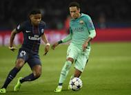 Barcelona forward Neymar (right) in action against Paris Saint-Germain during the side's Champions League clash at the Parc des Princes stadium on February 14, 2017