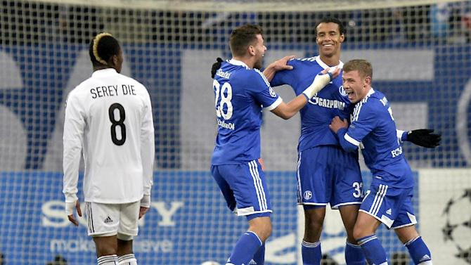 Schalke's Max Meyer, scorer Joel Matip and Schalke's Adam Szalai, from right, celebrate their side's 2nd goal during the Champions League Group E soccer match between FC Schalke 04 and FC Basel in Gelsenkirchen, Germany, Wednesday, Dec. 11, 2013