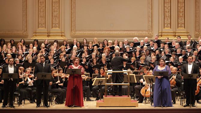 "In this  Dec. 5, 2012 photo provided by Carnegie Hall, soloists from left, Nicholas Houhoulis, Nicholas Pallesen, Jamie Barton, Angela Meade and Michael Spyres, perform Bellini's ""Beatrice di Tenda"" at Carnegie Hall in New York. James Bagwell, center, conductors, the Collegiate Chorale and the American Symphony Orchestra in the seldom-performed work. (AP Photo/Carnegie Hall, Erin Baiano)"