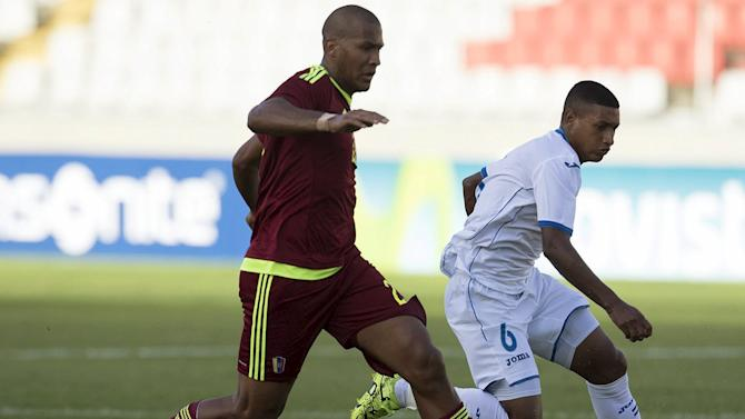 Venezuela's Salomon Rondon fights for the ball with Honduras' Bryan Acosta during their friendly soccer match at Cachamay stadium in Puerto Ordaz