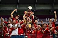 Spain's players celebrate with the trophy after winning the Euro 2012 football championships final against at the Olympic Stadium in Kiev on July 1. Spain beat Italy 4-0 to successfully defend their title