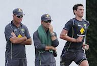 Australia's Mitchell Starc (R) delivers a ball as coach Mickey Arthur (L) and batting coach Justin Langer look on during an ICC Twenty20 Cricket World Cup practice session in Colombo, on September 26. Australia, South Africa, India and Pakistan, clubbed together for the Super Eights in the 'group of death', all came through unscathed by winning both their preliminary matches