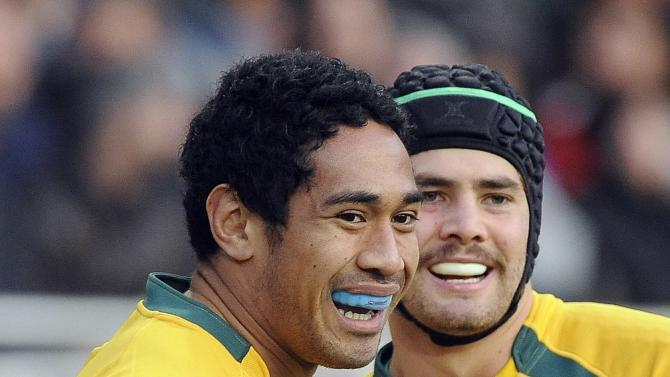 Australia's Joe Tomane and Liam Gill celebrate after winning their Six Nations rugby union match against Italy at the Olympic stadium in Turin