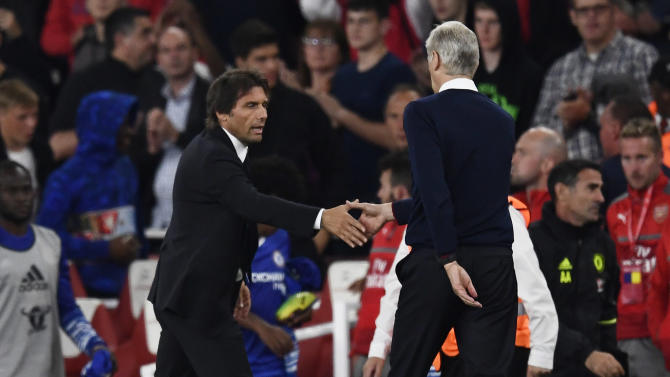 Chelsea manager Antonio Conte and Arsenal manager Arsene Wenger shake hands at the end of the match