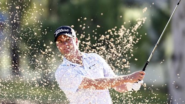 Webb Simpson hits from a sand trap on the 8th green during his World Golf Final Group 2 match in Antalya (Reuters)