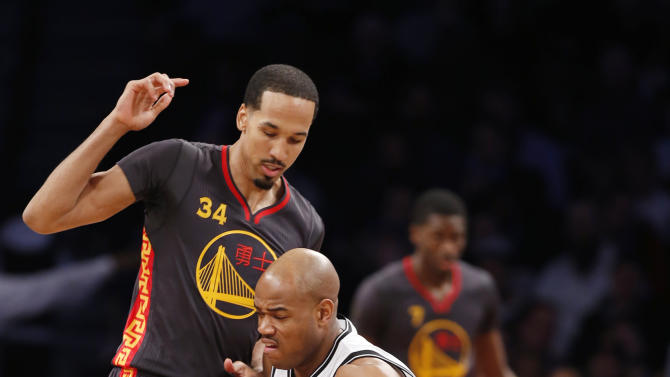 Brooklyn Nets guard Jarrett Jack, right, drives up against Golden State Warriors guard Shaun Livingston (34) in the first half of an NBA basketball game at the Barclays Center, Monday, March 2, 2015, in New York. (AP Photo/Kathy Willens)