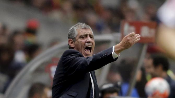 Portugal's coach Santos reacts during their Euro 2016 qualifying soccer match against Denmark at Municipal Stadium in Braga