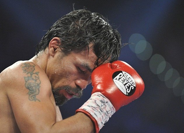 Manny Pacquiao of the Philippines concentrates during his WBO welterweight title match against Timothy Bradley of the US at the MGM Grand Arena on June 9, 2012 in Las Vegas. Pacquiao will likely face either of US fighters Brandon Rios or Mike Alvarado in Macau in November, his promoter Bob Arum said