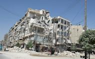 Damage caused by fighting between Syrian rebels and government forces is seen in the old city of Aleppo. Syrian troops backed by helicopter gunships clashed with rebels near a barracks in Aleppo as battles broke out around a military airport elsewhere in the northern province, monitors said