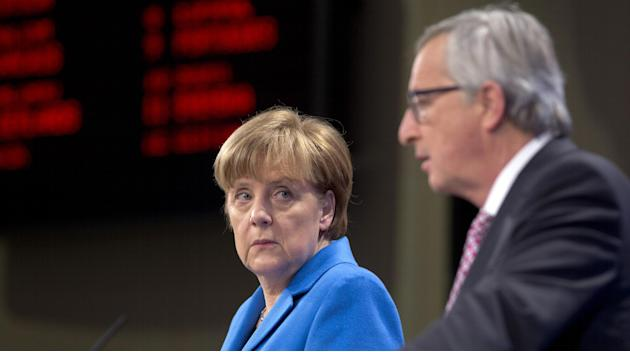German Chancellor Angela Merkel, left, and European Commission President Jean-Claude Juncker participate in a media conference at EU headquarters in Brussels on Wednesday, March 4, 2015. German Chance