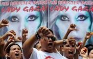 Members of Biblemode Youth Philippines protest in front of posters promoting Lady Gaga in Manila on May 19. Gaga is set to rock the Philippines later Monday amid more planned street protests and with censors in the house on orders to report any hint of blasphemy, devil worship, nudity or lewd conduct