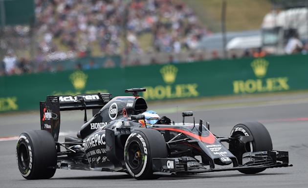 McLaren Honda's Spanish driver Fernando Alonso races during the British Formula One Grand Prix at the Silverstone circuit on July 5, 2015