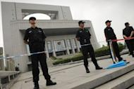 "Policemen stand guard outside the Intermediate People's Court in Hefei, Anhui province where four Chinese police officers are on trial in the Gu Kailai case. The wife of a former Chinese top politician at the heart of a scandal that has rocked the ruling Communist Party, has admitted murdering a British businessman and blamed her actions on a ""mental breakdown,"" according to state media"