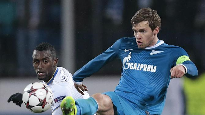 Zenit's Nicolas Lombaerts, right, clears the ball watched by Porto's Jackson Martinez during the Champions League group G soccer match between Zenit and Porto at Petrovsky stadium in St.Petersburg, Russia, on Wednesday, Nov. 6, 2013
