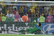 Italian goalkeeper Gianluigi Buffon watches as Ashley Young's penalty kick hirs the crossbar during Sunday night's penalty shootout in England's Euro 2012 quarter final against England