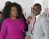 "Actors David Oyelowo and Oprah Winfrey, cast members of the film ""Lee Daniels' The Butler"", pose at the film's premiere in Los Angeles August 12, 2013. REUTERS/Fred Prouser"