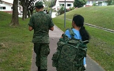 A photo of a national serviceman making his maid carry his backpack is making the rounds online. (Photo from Facebook)