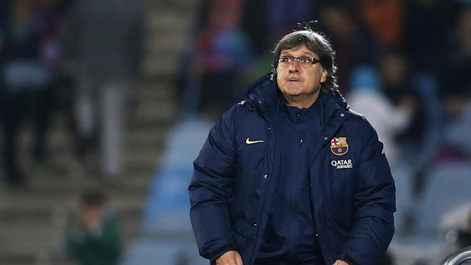 FC Barcelona's coach Gerardo 'Tata' Martino from Argentina gestures during a Spanish La Liga soccer match between FC Barcelona and Getafe at the Coliseum Alfonso Perez stadium in Madrid, Spain, Sunday, Dec. 22, 2013