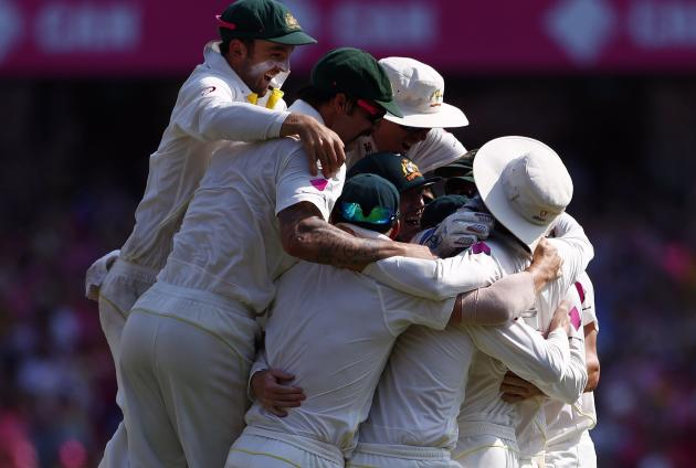 Australia's players celebrate after they won the fifth Ashes cricket test against England at the Sydney cricket ground