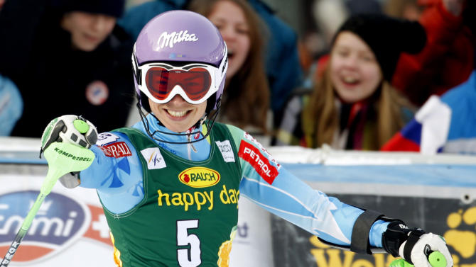 Slovenia's Tina Maze celebrates after winning an alpine ski, women's world Cup slalom, in Maribor, Slovenia, Sunday, Jan. 27, 2013. Overall World Cup leader Tina Maze rebounded from a close loss by posting an emphatic slalom victory before her home fans Sunday. Maze, who lost Saturday's giant slalom by 0.08 seconds to Lindsey Vonn, led after the opening run and clocked a two-run combined time of 1 minute, 33.68 seconds down the Radvanje course. (AP Photo/Pier Marco Tacca)