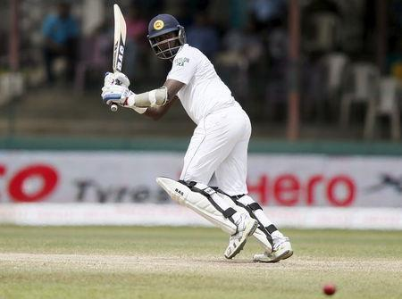 Sri Lanka's captain Mathews plays a shot during the final day of their third and final test cricket match against India in Colombo