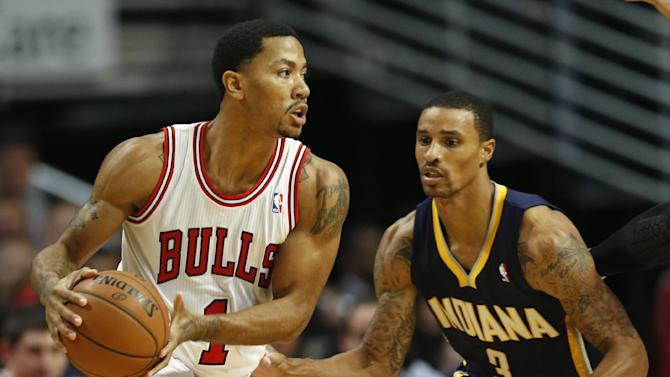 Chicago Bulls guard Derrick Rose (1) looks to pass the ball against Indiana Pacers guard George Hill (3) during a first quarter of an NBA basketball game in Chicago, Saturday, Nov. 16, 2013
