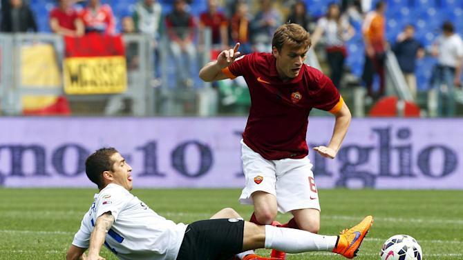 AS Roma's Ljajic challenges Atalanta's Carmona during their Serie A soccer match at the Olympic stadium in Rome