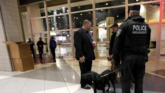 Homeland security officers K-9 unit stand inside the doors of the WWE Survivor Series, a professional wrestling event at Philips Arena in Atlanta