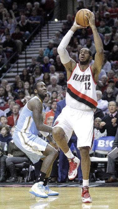 Portland Trail Blazers forward LaMarcus Aldridge, right, goes to the hoop past Denver Nuggets center JJ Hickson during the second half of an NBA basketball game in Portland, Ore., Thursday, Jan. 23, 2014.  Aldridge scored 44 points, pulled in 13 rebounds and sank 14 free throws as they beat the Nuggets 110-105