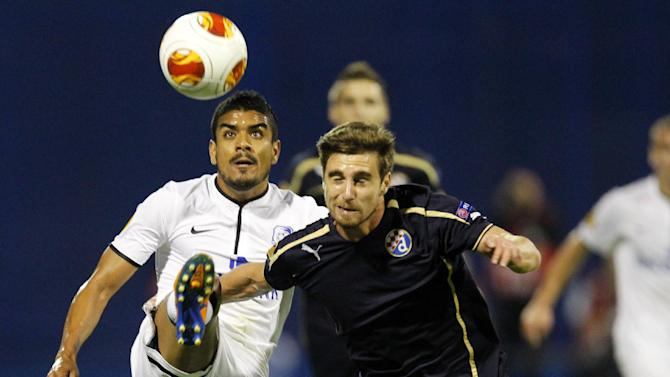Chornomorets Odessa's Leonardo, left, is challenged by Dinamo Zagreb's Ruben Limaduring their Europa League  group B soccer  match,   in Zagreb, Croatia, Thursday, Sept. 19, 2013