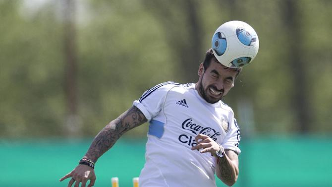 Argentina's Ezequiel Lavezzi heads the ball during a team training session ahead a Brazil 2014 World Cup qualifying soccer match against Peru in Buenos Aires, Argentina, Tuesday, Oct. 8, 2013
