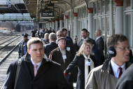 """Some of the 1,000 lobbyists, business owners and politicians gather on a platform at the Trenton train station waiting to board a train to Washington, D.C., Thursday, Feb. 16, 2017 in Trenton, N.J. The state Chamber of Commerce's 80th annual trip — nicknamed the """"Walk to Washington"""" because rail riders generally pace the train's corridors schmoozing and handing out business cards — comes after a national election that hinged in part on repudiating insiders and establishment politics. (AP Photo/Mel Evans)"""