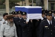 Members of the Knesset guard carry the flag draped coffin of former Israeli prime minister Ariel Sharon as he is laid in state at the Knesset, Israel's parliament, in Jerusalem January 12, 2014. REUTERS/Ronen Zvulun