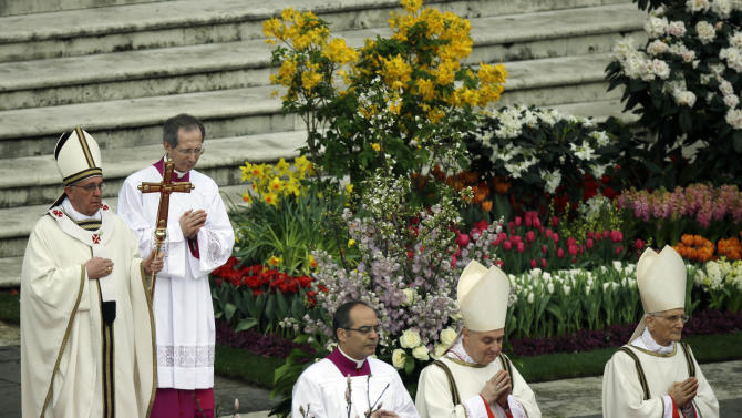 "Pope Francis, holding the pastoral staff, celebrates the Easter mass in St. Peter's Square at the Vatican, Sunday, March 31, 2013. ""Our daily problems and worries can wrap us up in ourselves, in sadness and bitterness, and that is where death is,"" he said. ""Let the risen Jesus enter your life, welcome him as a friend, with trust: he is life!"" said Pope Francis during the Easter vigil. (AP Photo/Gregorio Borgia)"