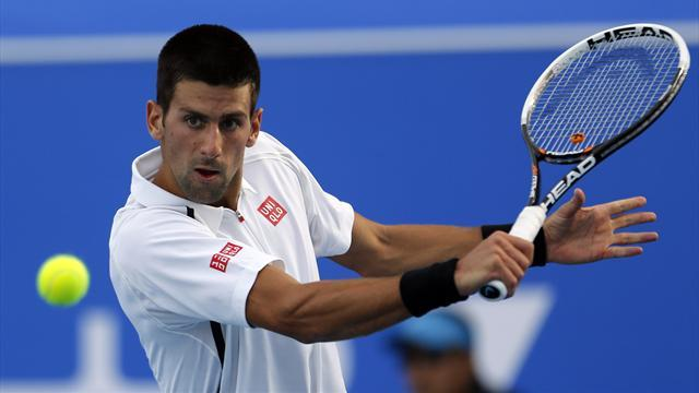 Tennis - Djokovic holds off Almagro in Abu Dhabi