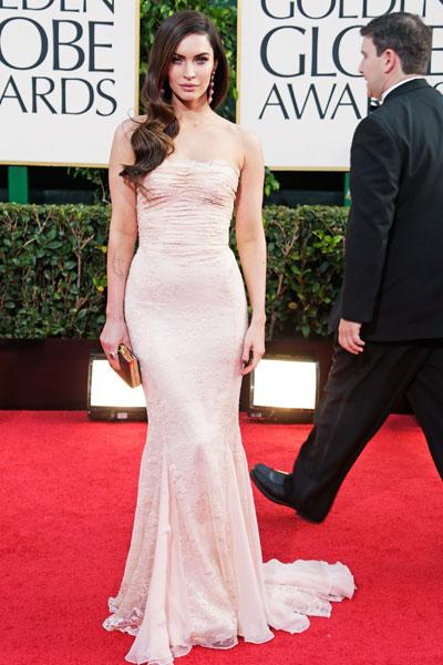 Megan Fox: The new mommy is back to her svelte self in a figure-hugging Dolce & Gabbana. Rather than accesorize with flashy jewelry, the actress lets her dress do the talking with the subtle white embroidery and ruffled top. It's Hollywood glam at its best. (Photo by Jeff Vespa/WireImage)
