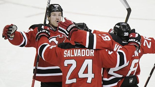 New Jersey Devils' David Clarkson (L) and Anton Volchenkov congratulate teammate Bryce Salvador (24) after his goal on the Los Angeles Kings