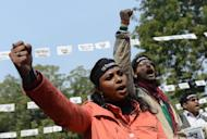 """Indian protesters shouts slogan during a protest against last month's gang rape and murder of a student, in New Delhi on January 29, 2013. Verdicts for five men accused of the fatal gang-rape of a student on a New Delhi bus would be handed down """"very soon,"""" a defence lawyer has said, as an application to relocate the trial failed"""